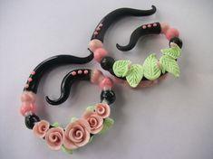 http://www.etsy.com/listing/67553487/rose-garden-polymer-clay-ear-gauges
