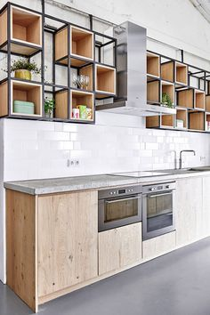 Metal frame with removable wooden cubes for upper cabinets. Fairphone Head Office, Amsterdam by Melinda Delst