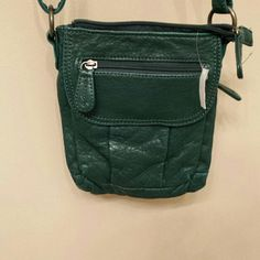 Small crossbody bag! Need a place to put your chapstick and wallet?  Purchase this purse to sling across yourself and you'll be able to put all you need into here! Bueno Bags Crossbody Bags