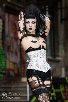 Get cinched with Bats & Webs of Deceit! This corset is made of Cotton Coutil with each panel individually hand printed with cobwebs and now available with bats. No two corsets will ever be the same! This also features a secret embroidered spider in the lining... It also features external casings which contain the usual skeleton of steel boning for maximum cinch and comfort. Shown here in the Brazen underbust style with front busk closure and silver print. *Let me know if you would like b...