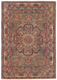 Laver Kirman, Western Persian, 4ft 2in x 5ft 10in, Circa 1850. This extremely early example of the revered Laver Kirman court style is reflective of the heights this floral tradition sometimes reached. A vibrant, remarkable design is born through masterful craftsmanship. Sectioned off by ingenious outlines of flowing vinery, yet seamlessly integrated into the whole, the intricacy of the multi-layered field is unfathomable in its articulation of the most minute details.