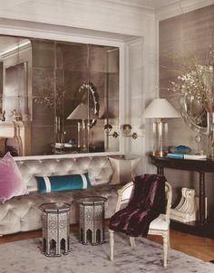 Grey silk rug, grey silk sofa, Moroccan inlaid tables, mirror.