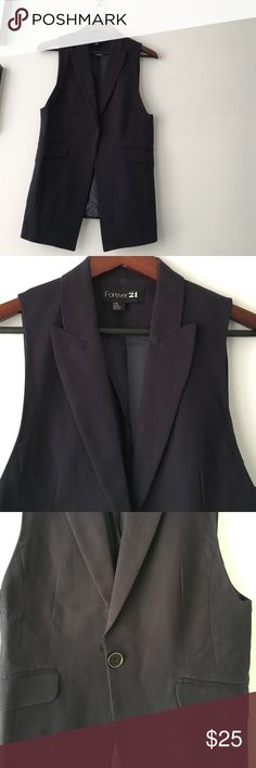 Long Navy Waistcoat Great over a white tshirt and jeans, or with a blouse and pants to work. 1 button closure, 2 pockets, very elegant & flattering. Forever 21 Jackets & Coats Vests