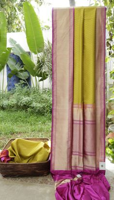 This Benares silk is in pistachio green with a thread work pattern throughout the sari. The complementing border and pallu are in purple with an intricate gold zari weave. The borderwitha splash ...