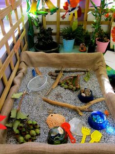 Sand table container wrapped up in burlap -  sensory experience with natural and loose materials at Sandringham Primary School ≈≈ http://www.pinterest.com/kinderooacademy/provocations-inspiring-classrooms/
