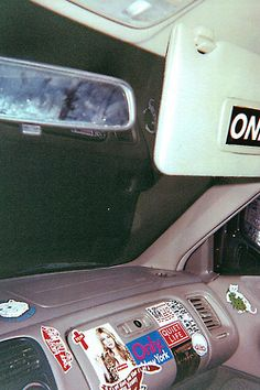 The inside of Lillie's car was spacious, I wanted to prop my booted feet up on the dash but I didn't want to muck up the vast amount of stickers that were spreading across the dashboard.