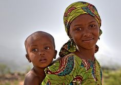 fulani tribe, nigeria. The mama looks so young!