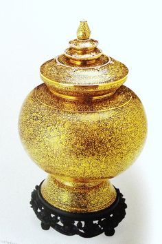 Lustral water jar in gold and silver niello with diamonds ornaments.