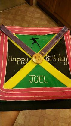 Jamaican and Usain Bolt inspired cake design.... My nephews cake xxx yummy