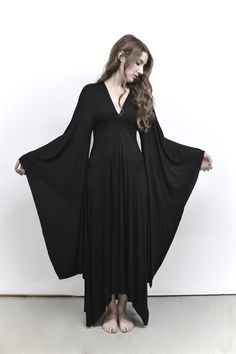 NUIT objects are designed and handmade in the Toronto Atelier. All currency listed in CAD.Pin tuck detail gown with draped Kimono Sleeve and hem. Flatters all body types. Pull on design.Con...