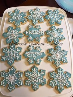 Custom Frozen inspired snowflake cookies for a birthday party. Decorated with royal icing.