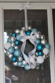 Easiest DIY Christmas Wreath Ever--you only need some Christmas balls, a wire coat hanger and some ribbon! //Beautiful Life Made Easy.