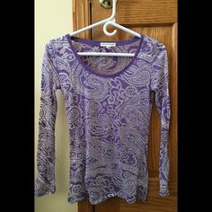 Long-sleeved purple shirt I absolutely love this shirt but sadly purple doesn't match my skin tone. You need to wear a tank top underneath since it is see-through but it is a very pretty shirt and in perfect condition. Aeropostale Tops