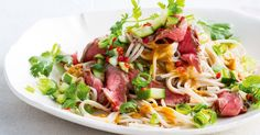 A tasty beef and noodle salad served with an easy to make satay sauce.
