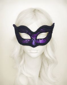Venetian style masquerade mask covered black lace on metallic purple surface. Framed with black braided trim, small black rhinestones on the corners of the eyes.  Please allow 1-2 weeks processing time before shipping since its made to order. After that your order will be delivered within 3-5 business days with online tracking by DHL or UPS. Contact number is required to be given to shipment agency. Please note that delivery will be made by signature confirmation so somebody should be ready…