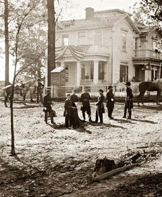 Federal officers in front of a home in Atlanta, Georgia during the Civil War.