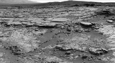 """The sinuous rock feature in the lower center of this mosaic of images recorded by the NASA Mars rover Curiosity is called """"Snake River."""" The images in the mosaic were taken by Curiosity's Navigation Camera during the 133rd Martian day, or sol, of the rover's mission on Mars (Dec. 20, 2012). On Sol 147 (Jan. 3, 2013), Curiosity drove about 10 feet (3 meters) to get a closer look at Snake River for before proceeding to other nearby rocks. Image Credit: NASA/JPL-Caltech"""