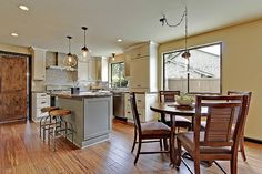 Photo gallery of remodeled kitchen features CliqStudios Dayton Painted Linen and Harbor gray cabinets