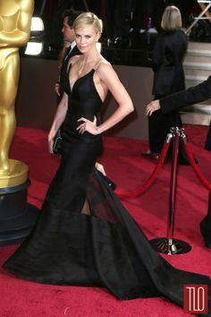 Charlize Theron attends the 86th Annual Academy Awards in Hollywood, California in a Christian Dior gown accessorized with Harry Winston jewelry.