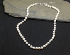 Pearl knotted necklace  'snow drops' aqua blue by Mollymoojewels