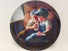 A limited edition collectors plate by Americas premiere childrens artist, Donald Zolan. Entitled Little Engineers, this is the second plate in