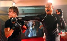 Enter Marty Deeks - NCIS: Los Angeles   Special Agent Sam Hanna goes undercover as a Mixed Martial Arts fighter and battles Jason Wyler (Marty Deeks) in the cage.