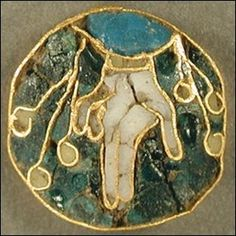 Gold and enamel Anglo-Saxon roundel: gold tray inlaid with cloisonne enamel; depicting the right Hand of God in opaque white enamel. Late 10th/early 11th Century - found by an armature metal detectorist in Hampshire, England and currently housed in the British Museum.