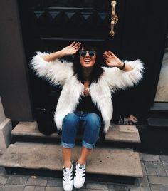 Coat: white fur fur white jeans denim blue jeans cuffed jeans top black top sunglasses sneakers low