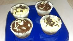 Chocolate cupcakes with chocolate or vanilla frosting and white and dark chocolate curls