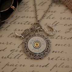 Cute shotgun shell necklace.... (wheels turning) bingo can totally make this