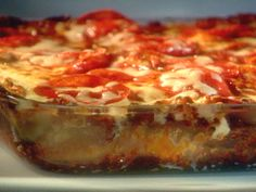 Blazy's Pepperoni Studded Lasagna from Guy Fieri FoodNetwork.com. A serious crowd pleaser! Better if made 2 days in advance.
