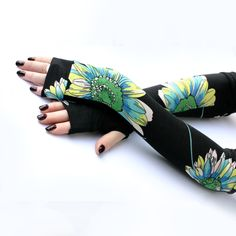 Long black fingerless gloves with large flowers could be a fun way to cover some of the psoriasis on her hands and arms.  I think I could pull this off.