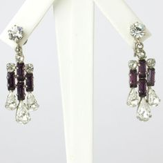 Deep-amethyst glass stones along with teardrop-shaped and round diamanté form these 1930s Austrian Art Deco earrings.
