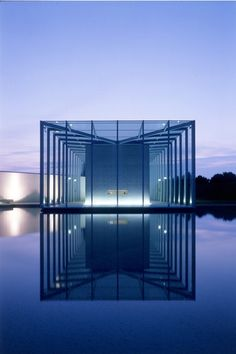 Concrete cube in glass shell.