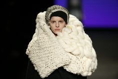 Woman on runway wearing ivory chunky knit scarf