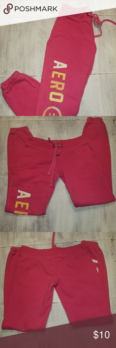 Aeropostale Pink Drastring Sweatpants Size XS Pink draw string sweatpants with ruched bottom at ankles. Orange and White writing down leg with smiley face. 70% cotton/ 3p% polyester. Aeropostale Pants