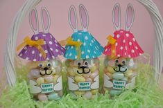 DIY Easter bunny bottles.  All u need is a water bottle, cupcake papers and cut out bunny ears and paws.  Fill with jelly beans and your done!