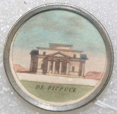 "ca 1780 French button, of a watercolor scene under glass, set in metal. The title is ""De Picpuce"" (I can't find a translation so it must be a place name}."