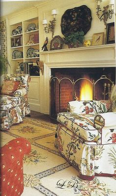 big wood burning fire - lovely armchairs to each side... love the feeling it evokes.