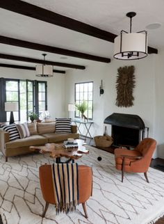 desiretoinspire.net, love the beams, piece over fireplace, and placement of furniture