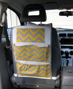 Car Organizer- Yellow and Gray Chevron. via Etsy. -- our new SUV toy & book organizer! Picked the grey chevron fabric (to match our grey leather) with a fun pop of yellow! Can't wait for it to get there! The bin on the floorboard just isn't cutting it anymore. LOL