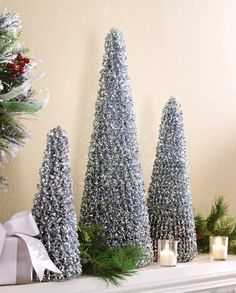 Winter Sparkling Silver Holiday Cone Trees - Sparkling silver trees will add a splash of fun to your holiday decorating Link Silver Christmas Decorations, Tabletop Christmas Tree, Xmas Tree, Christmas Themes, All Things Christmas, Holiday Ideas, Frozen Fever Party, Disney Frozen Birthday, Cone Trees