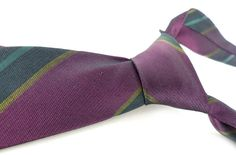 Vintage authentic old school Don Draper skinny silk necktie by Wembley. Gorgeous deep grape purple, teal , black and gold diagonal stripe. by ModernRenaissanceMan on Etsy https://www.etsy.com/listing/458625554/vintage-authentic-old-school-don-draper