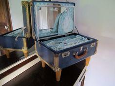Vintage little suitcase repurposed as a travel vanity table