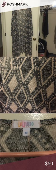 LuLaRoe Sarah cardigan size M Selling a LuLaRoe Sarah in like new condition. It's a bit too long for my taste. It's a beautiful diamond patterned design in neutral colors. Size medium. LuLaRoe Sweaters Cardigans
