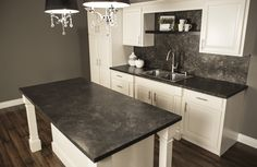 DIY Kitchen remodeling-how to refinish laminate countertops. With 4 easy steps, you can have a classy, designer beautiful and DIY friendly kitchen countertop in your kitchen with hand-painted paper countertops!