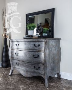 """Very excited to finally post this piece and my new specialty finish I'm calling 'Knights Armor.' This Large Bombay Chest updates any bedroom or entry way with an elegant and classically aged style. ""Hand-painted using General Finishes Queenstown Gray Milk Paint as a base coat, with a secondary coat of Argentine Pearl, Pearl Effects; painted on and textured to give this unique look. Then layers of Bronze & Tawny Pearl Effects, applied to add to the depth."