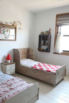 rustic kids room with red and white mushroom woodland theme