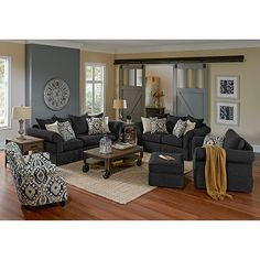 Living Room Furniture - Gramercy Sofa Tan walls with grey accents and charcoal grey furniture with accent chair...LOVE the grey barn doors!