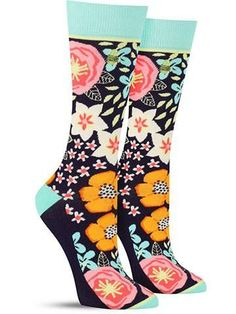 "These unique and fun floral socks pair a bold flower print with a phrase tucked away on the soles: ""La vie en rose,"" which means ""life in pink."" Seeing things through rose-colored glasses must not be"